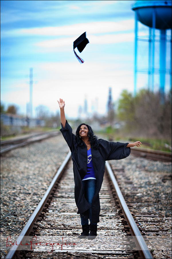 high school senior throwing cap into the air