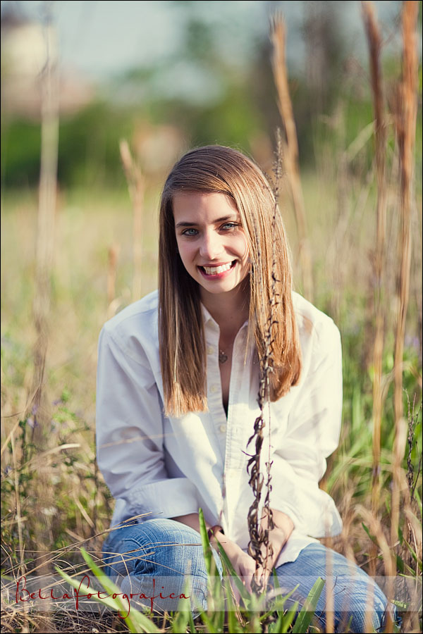 senior pictures in a field of cattails