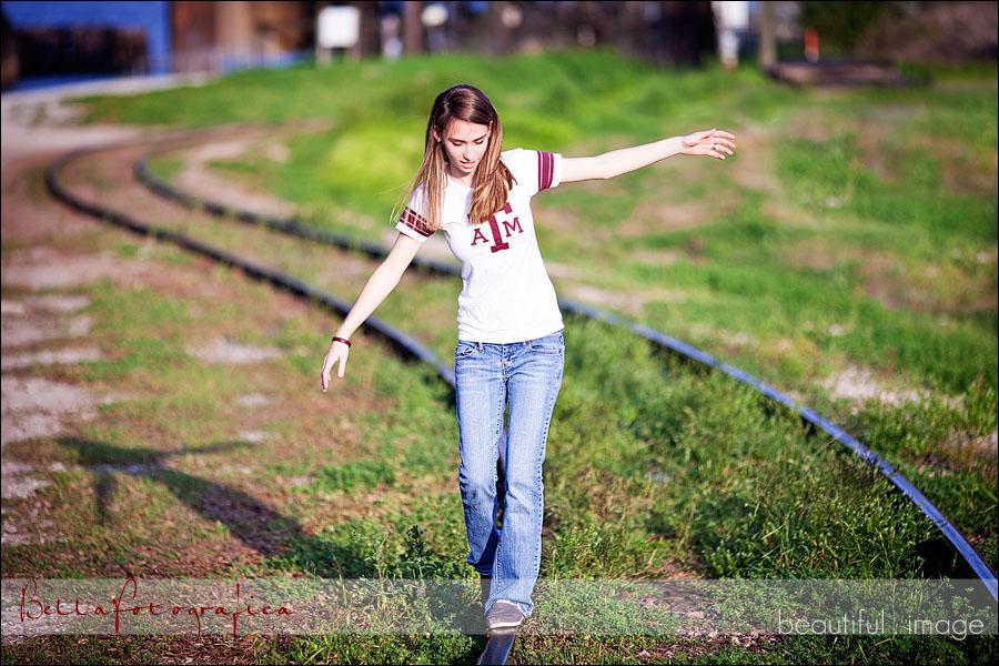 senior on railroad tracks