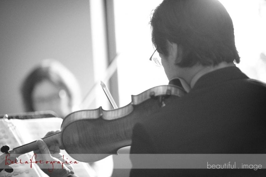 violins playing at wedding