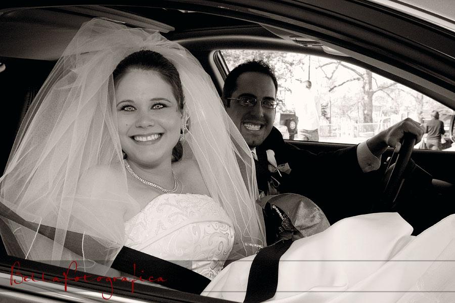 Bride and Groom in car making getaway