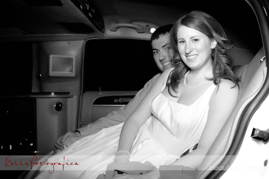 bride and groom in the limousine