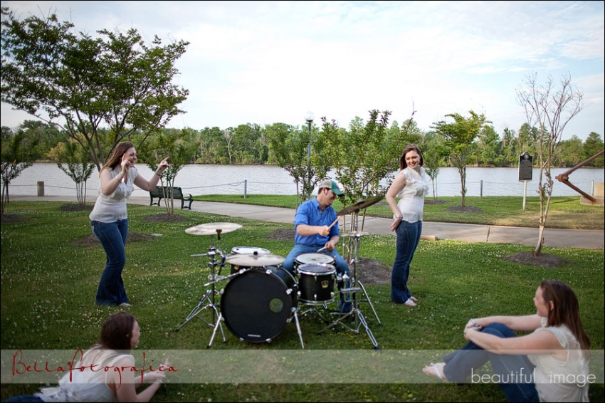 guy playing drums while girl watches