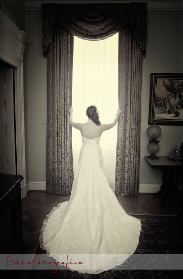 bride in front of bright curtains