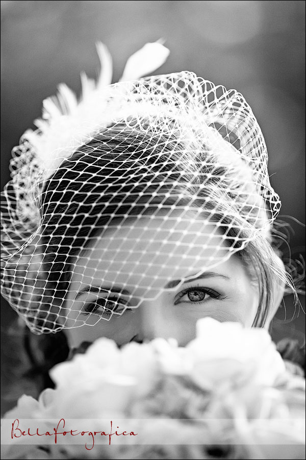 bride looking over her bouquet