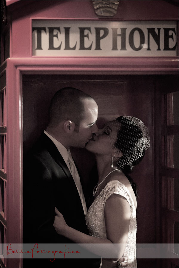 bride and groom in a telephone booth