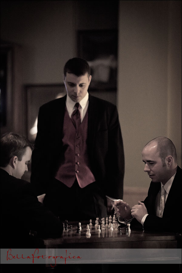 groom and best man playing chess