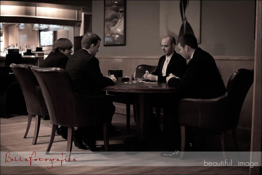 groom and groomsmen playing poker
