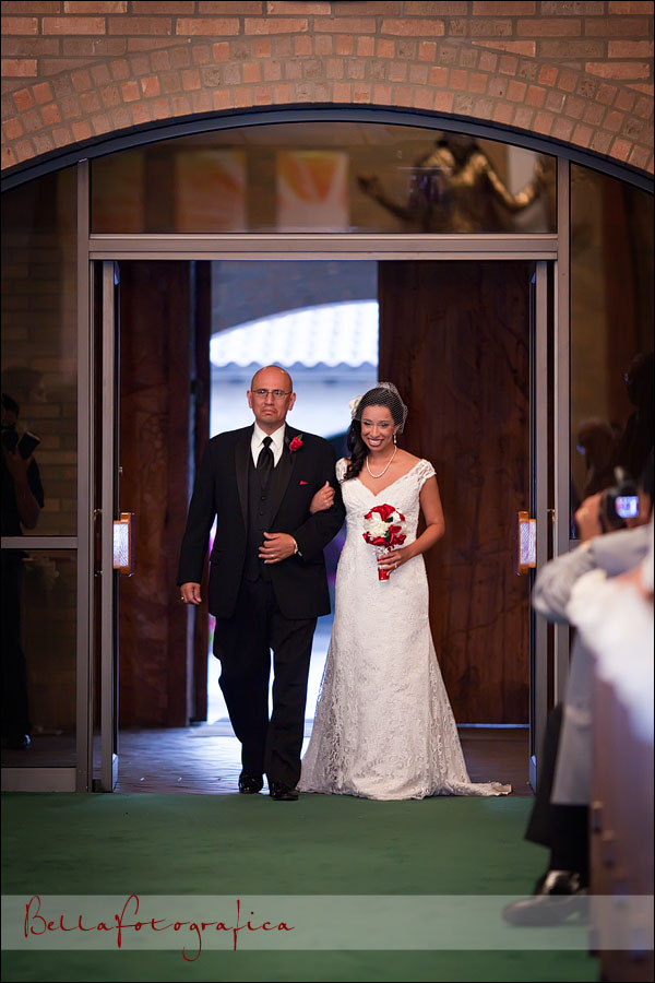 bride and dad walk up the aisle