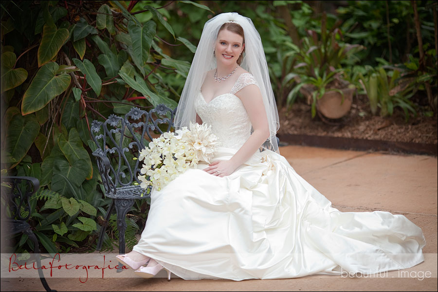 bride sitting on park bench
