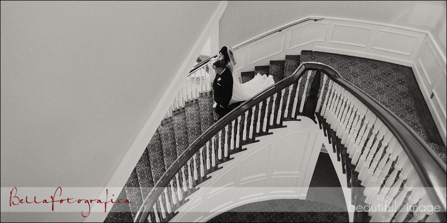 dad walking his daughter down the stairs