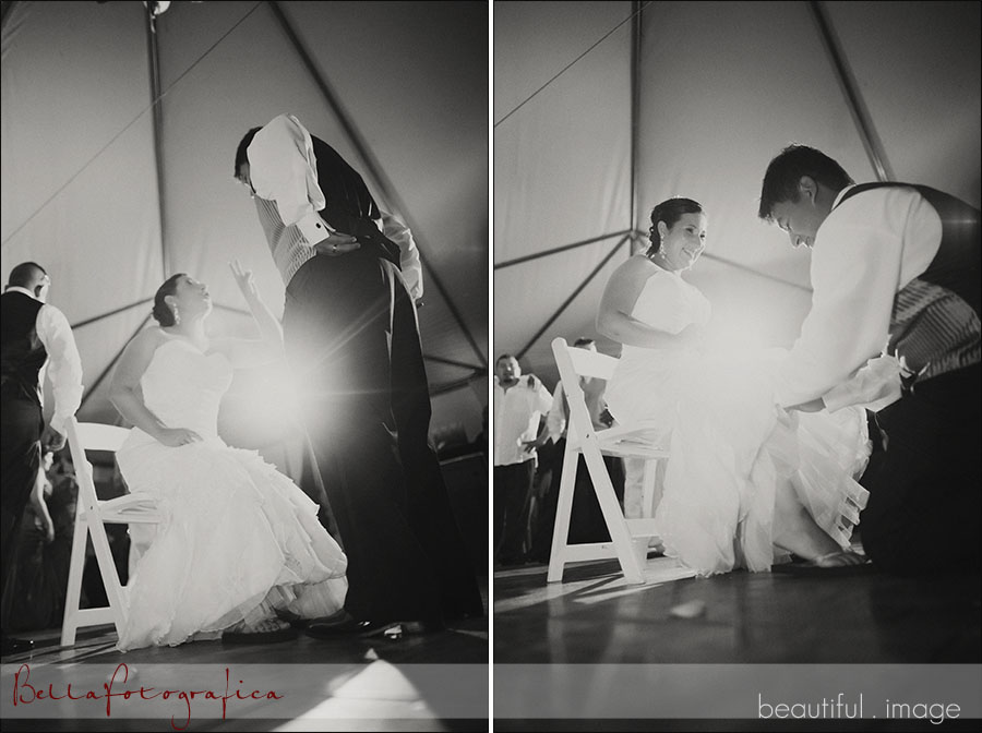 groom removing garter belt