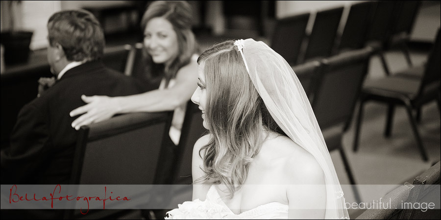 bride getting ready at the church with her parents