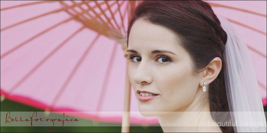 outdoor bridal photos with pink parasol