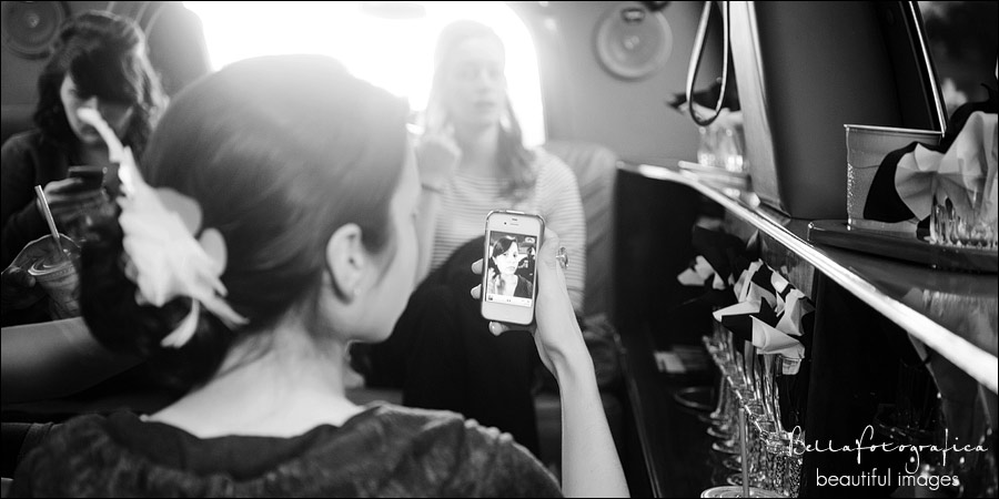 bride checking her hair in her phone