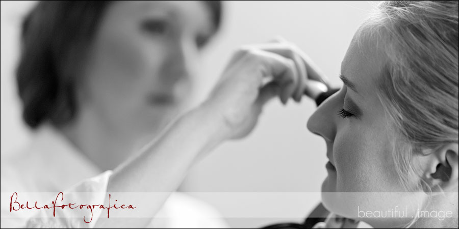 bride getting her makeup touched up