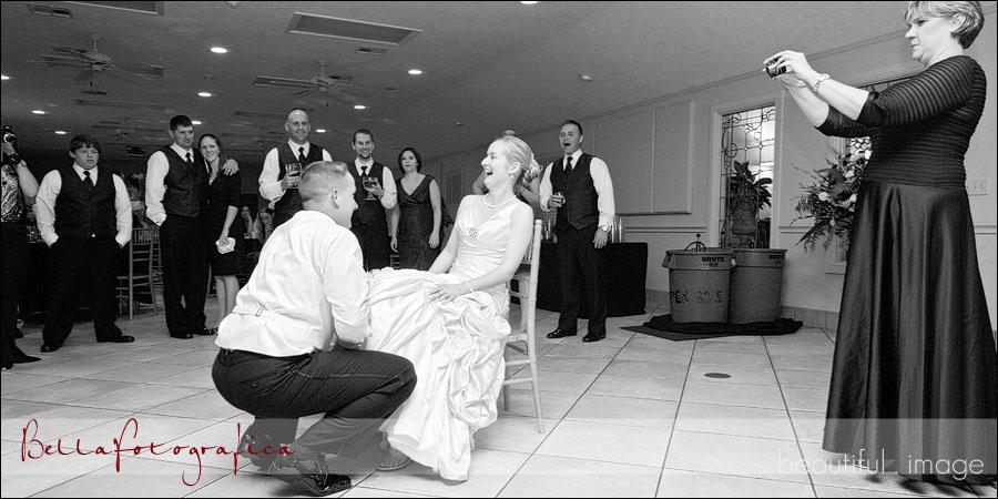 groom getting the garter
