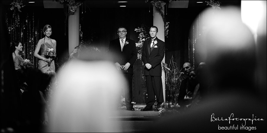 groom watching as bride makes her entrance with her dad