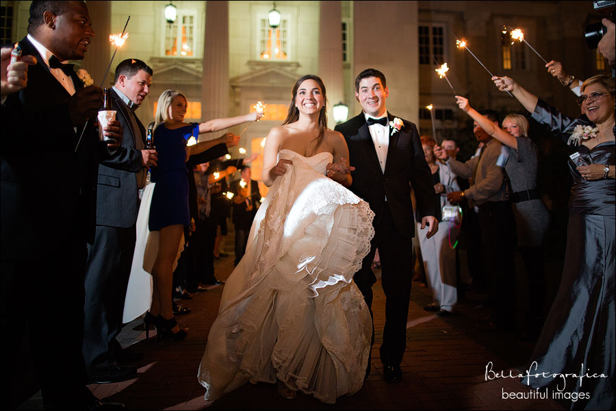 bride and groom leaving through sparklers
