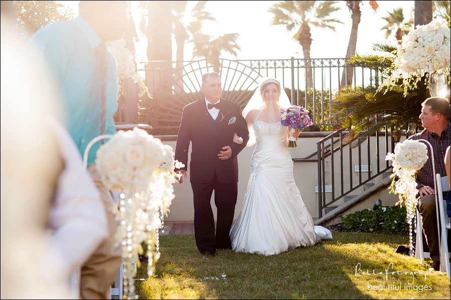 father walking bride down aisle in outdoor wedding