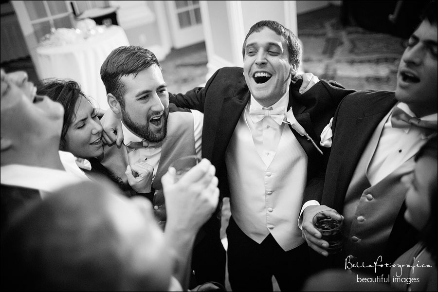 groom and his buddies singing at his reception