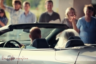 bride and groom leaving in car