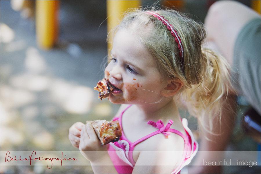 toddler eating BBQ ribs