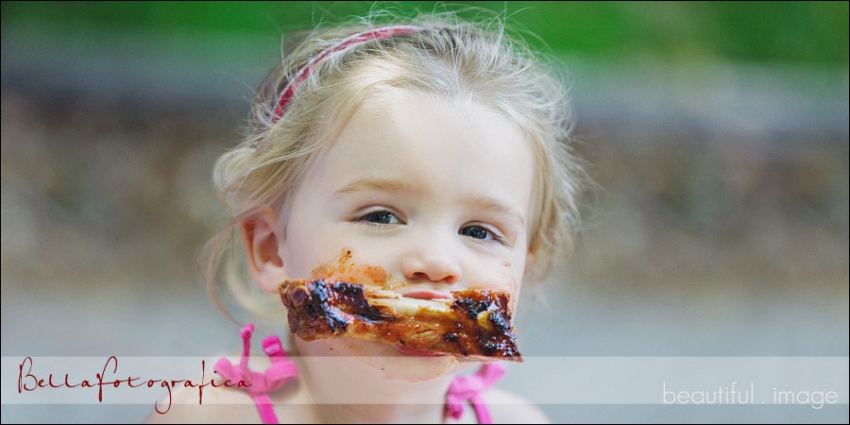 toddler eating BBQ ribs